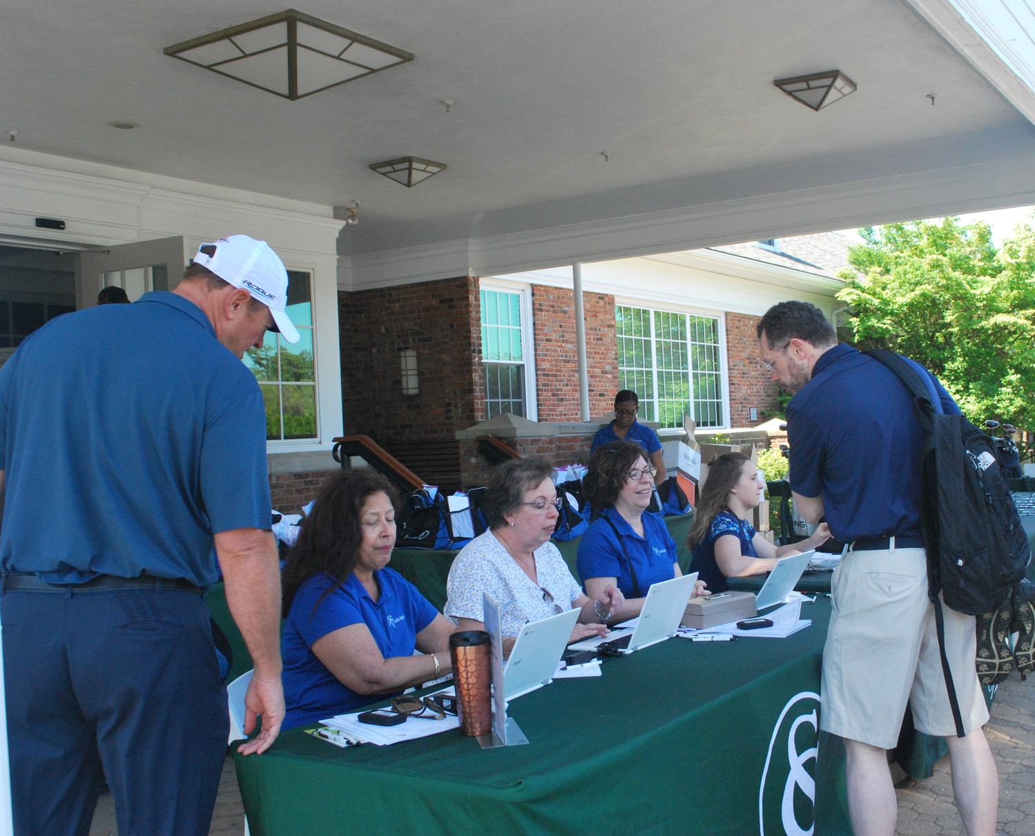 Check-in was busy as golfers arrived throughout the morning.