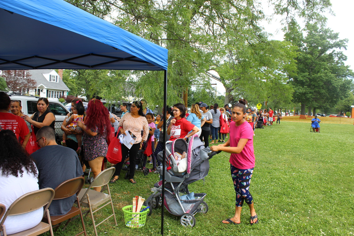 Dozens of residents from East Meadow and Westbury lined up to participate in Hope Day, hosted by New Hope Church and Shelter Rock Church and held this year at Bowling Green Elementary School in Westbury.