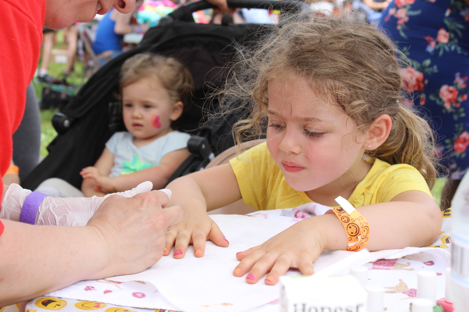 Maia Deoliveira, 4, got her nails painted at Hope Day. Children could also get their faces painted, enjoy bounce houses, snow cones, stuffed animals and books, among other free amenities.