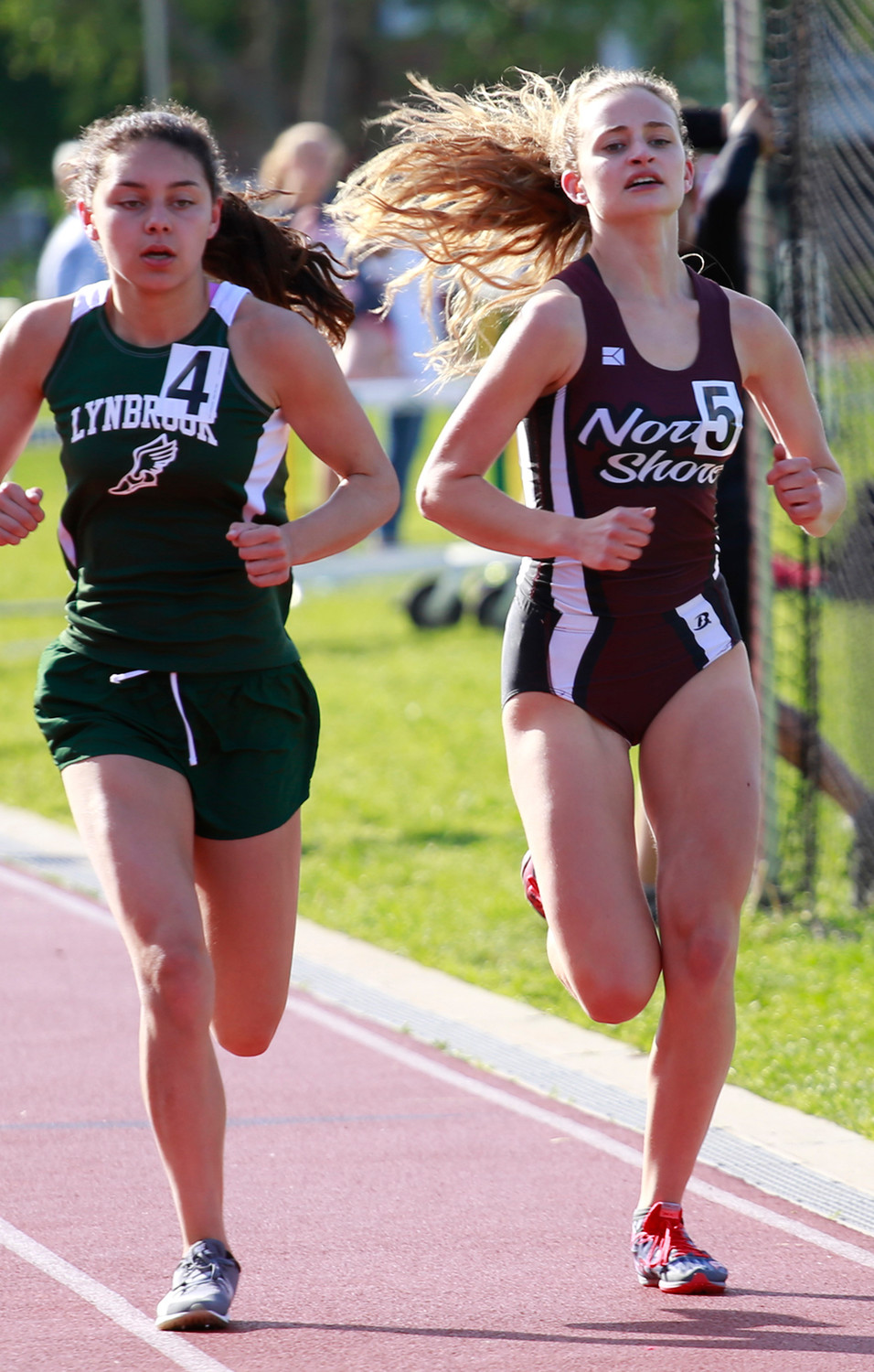 North Shore's Isabella Strajanekova, right, finished second in the 2000 meter steeplechase at the Nassau Class A championship meet on May 24.