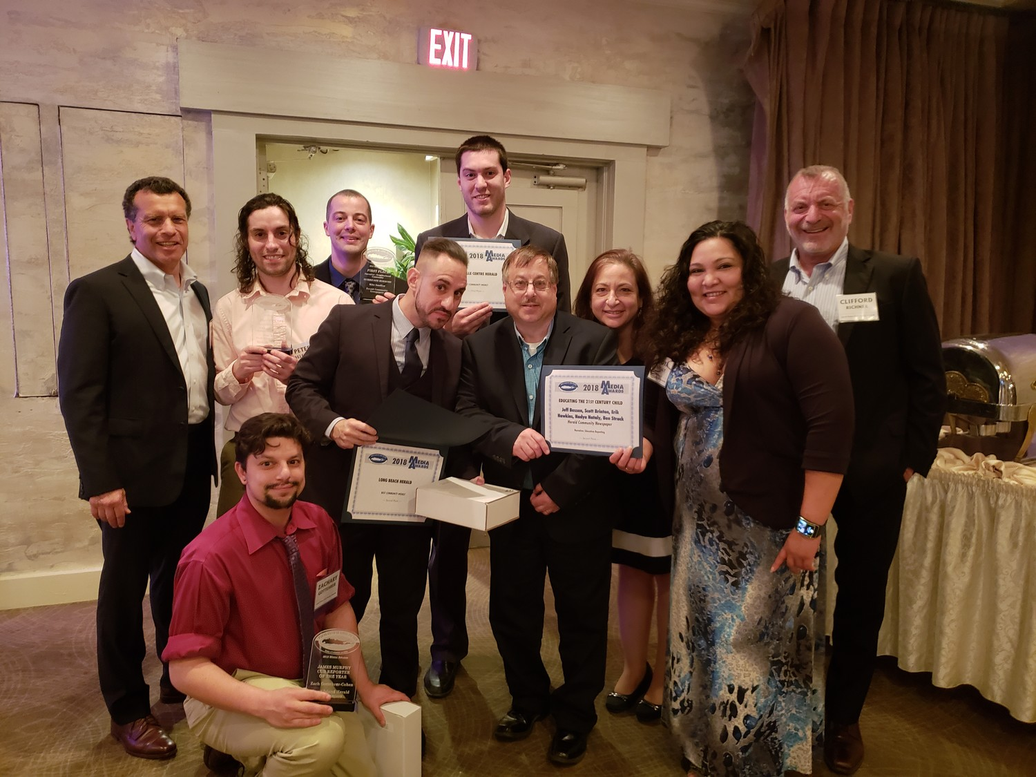 The Herald team had a blast at the Press Club of Long Island's annual Media Awards on Thursday, including, at front, kneeling, Zachary Gottehrer-Cohen, and, back row, from left, Stuart Richner, Peter Belfiore, Mike Smollins, Tony Rifilato, Ben Strack (at back), Jeff Bessen, Eden Laikin, Nadya Nataly and Clifford Richner. Missing was Hawkins, and Scott Brinton, who, as PCLI's incoming president, was helping to run the awards show throughout the evening.
