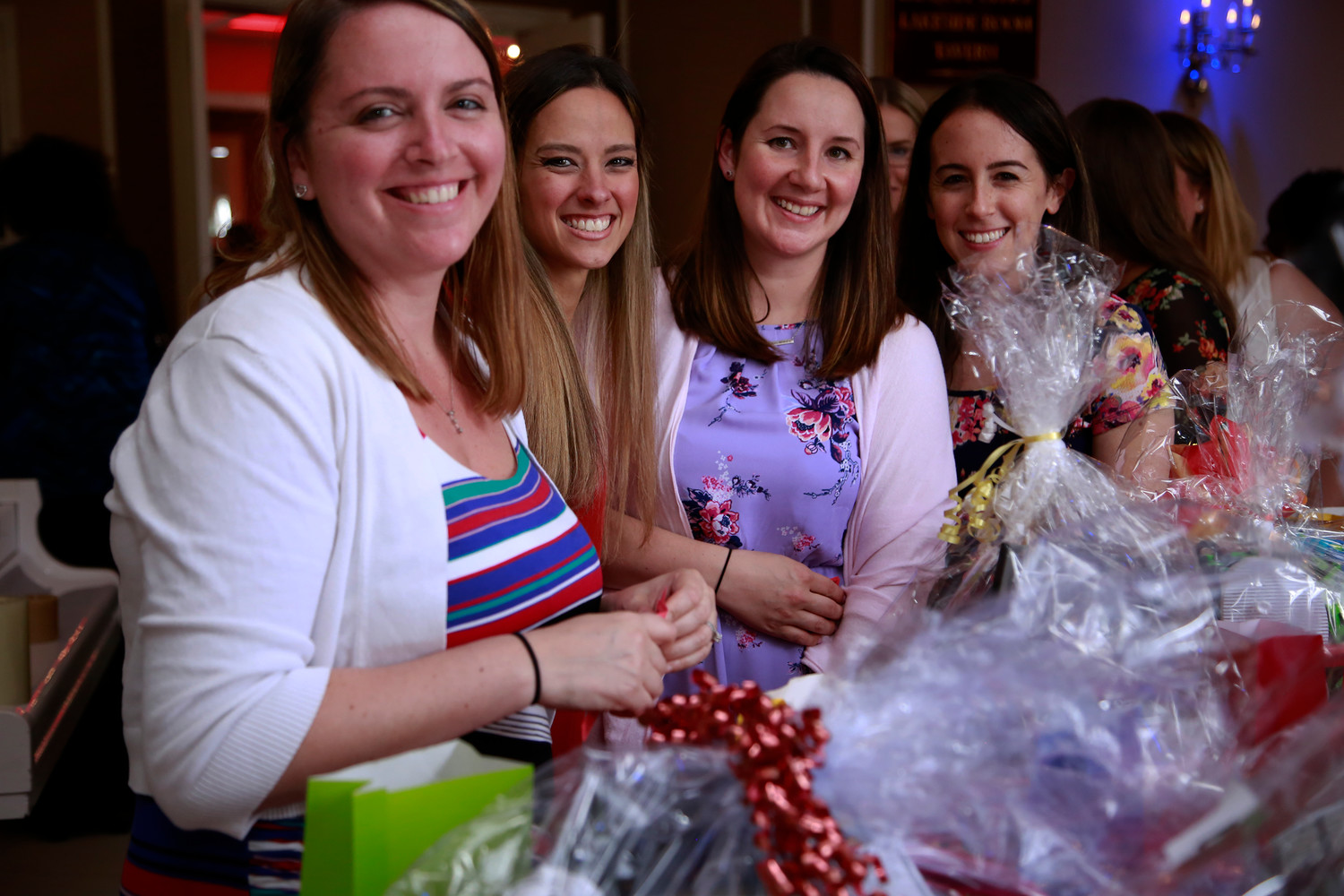 Teachers from Archer Street School, Jennifer Skelly, Brook McKenna, Lisa Scarola and Danielle Appel, were all smiles before they browsed the raffle baskets.