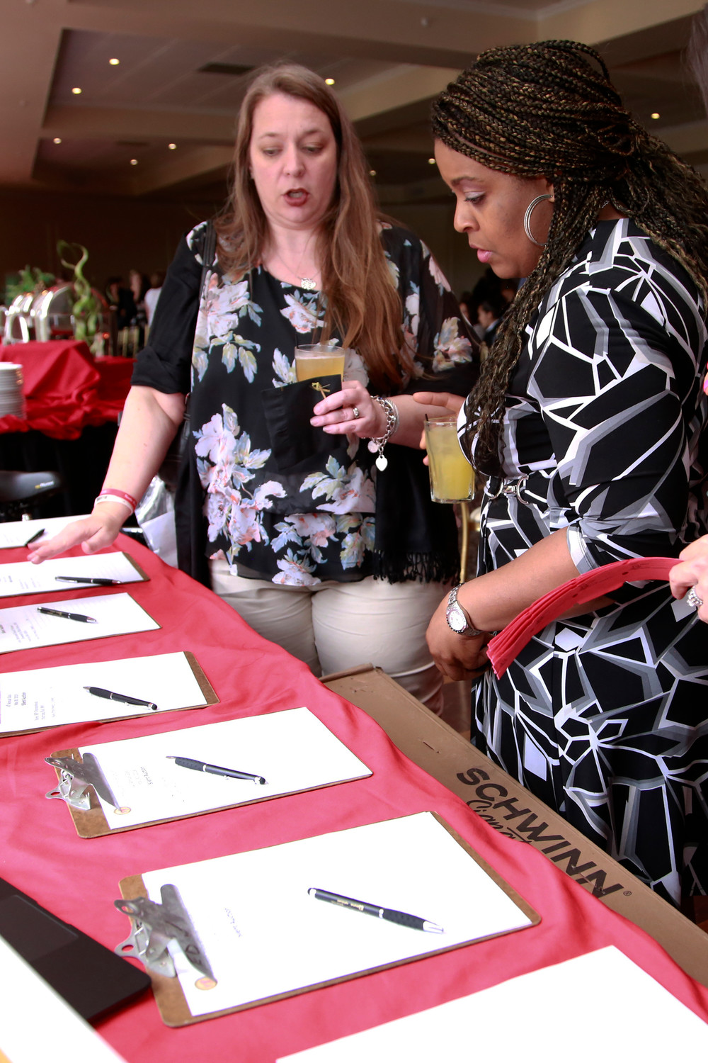 Dawn De La Llera and Nicole Smith consider bidding on silent auctions items.