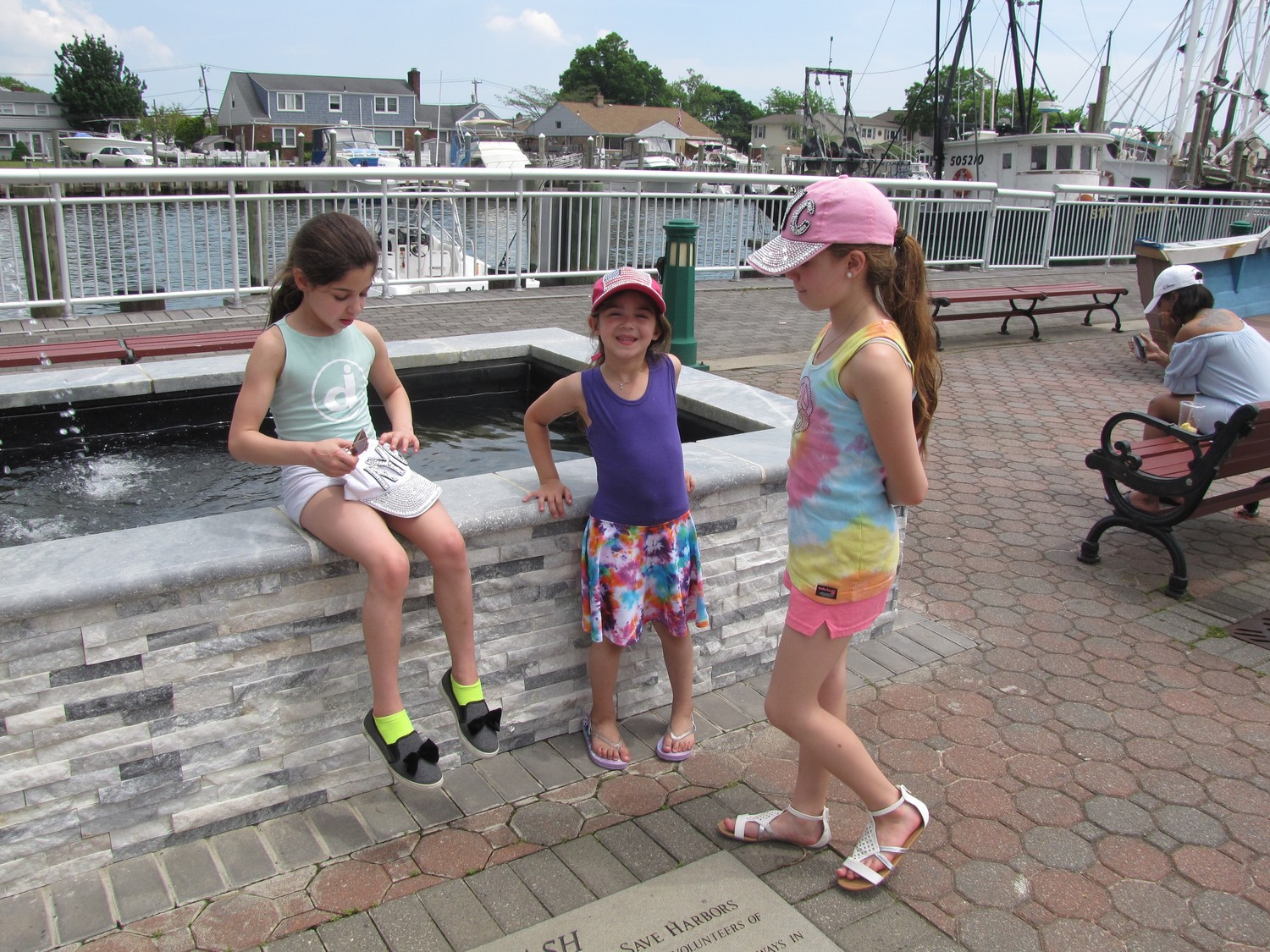 Bellmore Sisters Violet, left, Clara and Sophia Benno took a break from walking around the Nautical Mile.