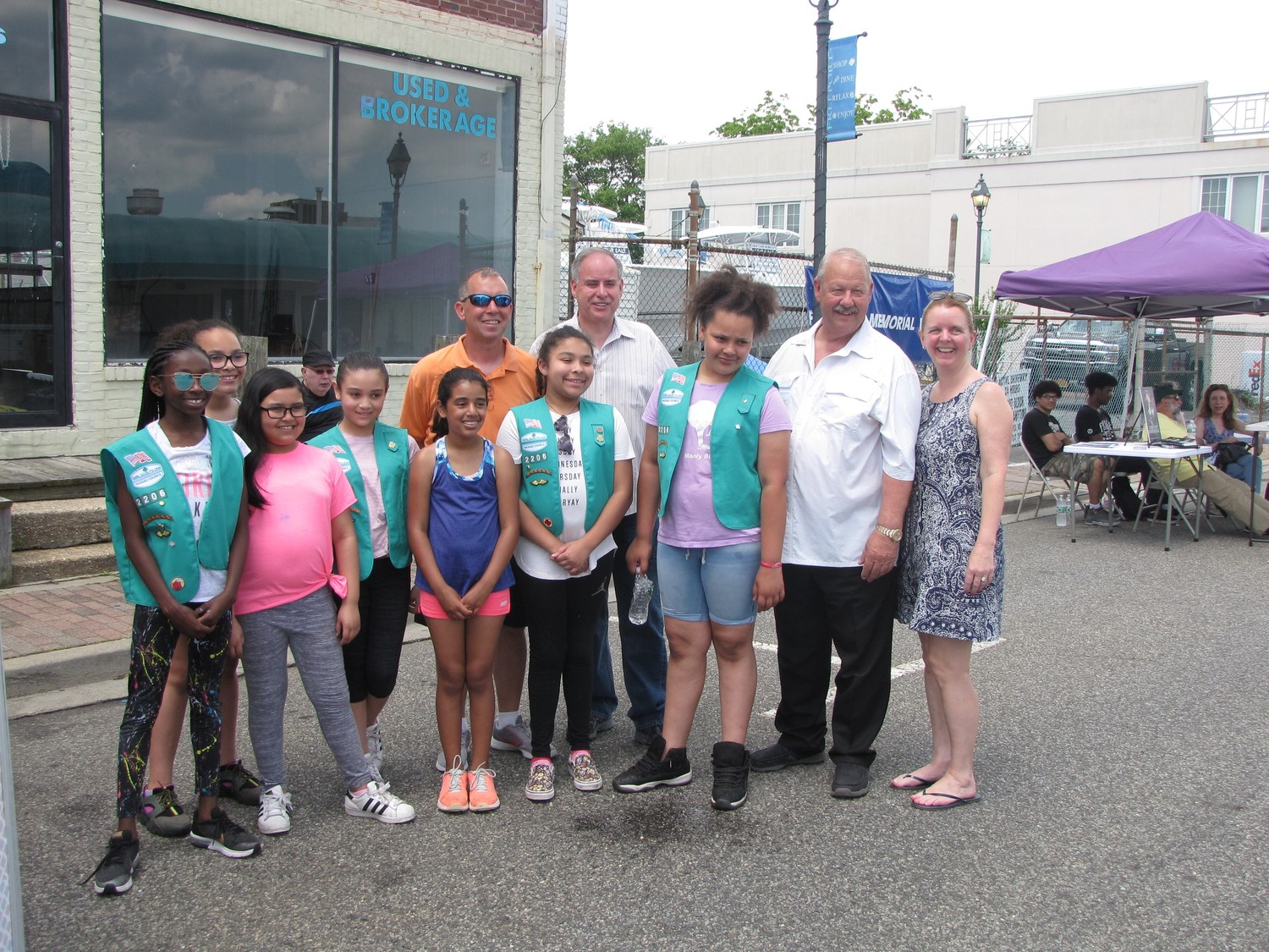 Mayor Kennedy, second from right, with Freeport Police Department Chief Miguel Bermudez, fourth from right, County Legislator Debra Mule, far right, and members of Freeport Girl Scout Troop 2206.