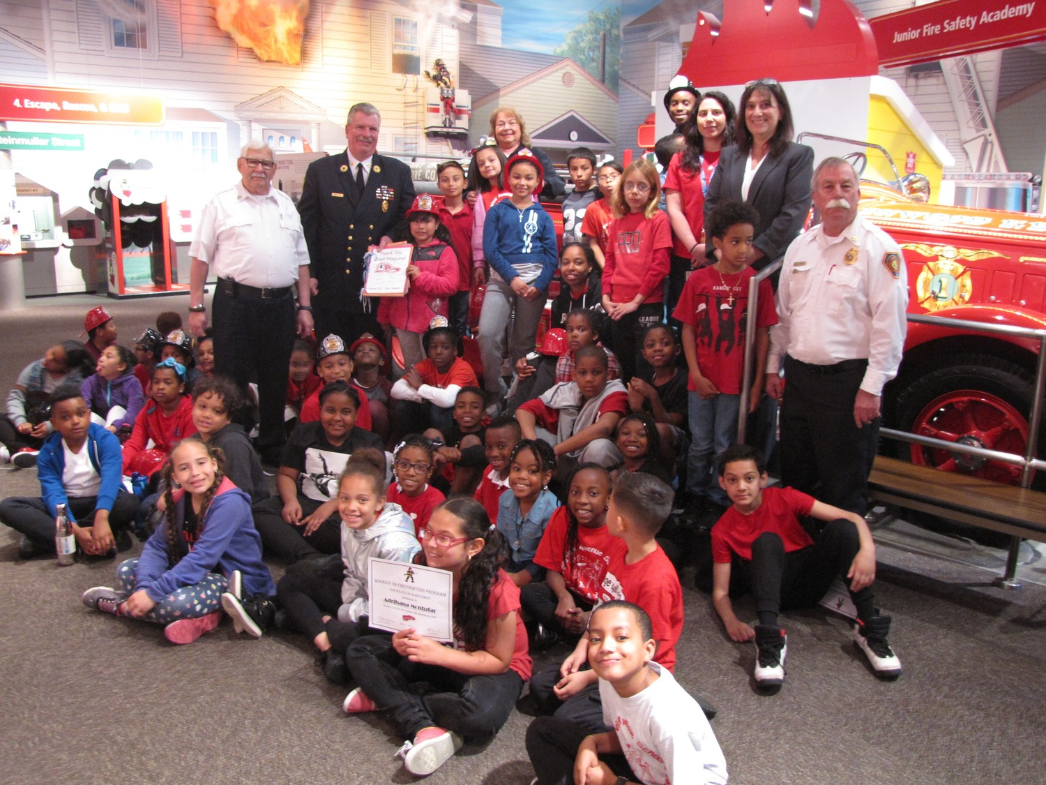 "Bayview Avenue School third graders, the Freeport Fire Department, along with staff from the Nassau County Firefighters Museum and Education Center were all smiles after learning about the history of firefighters in Nassau County on May 31 at the International Firefighters Luncheon as a part of the ""Hooked on Firefighers"" program."