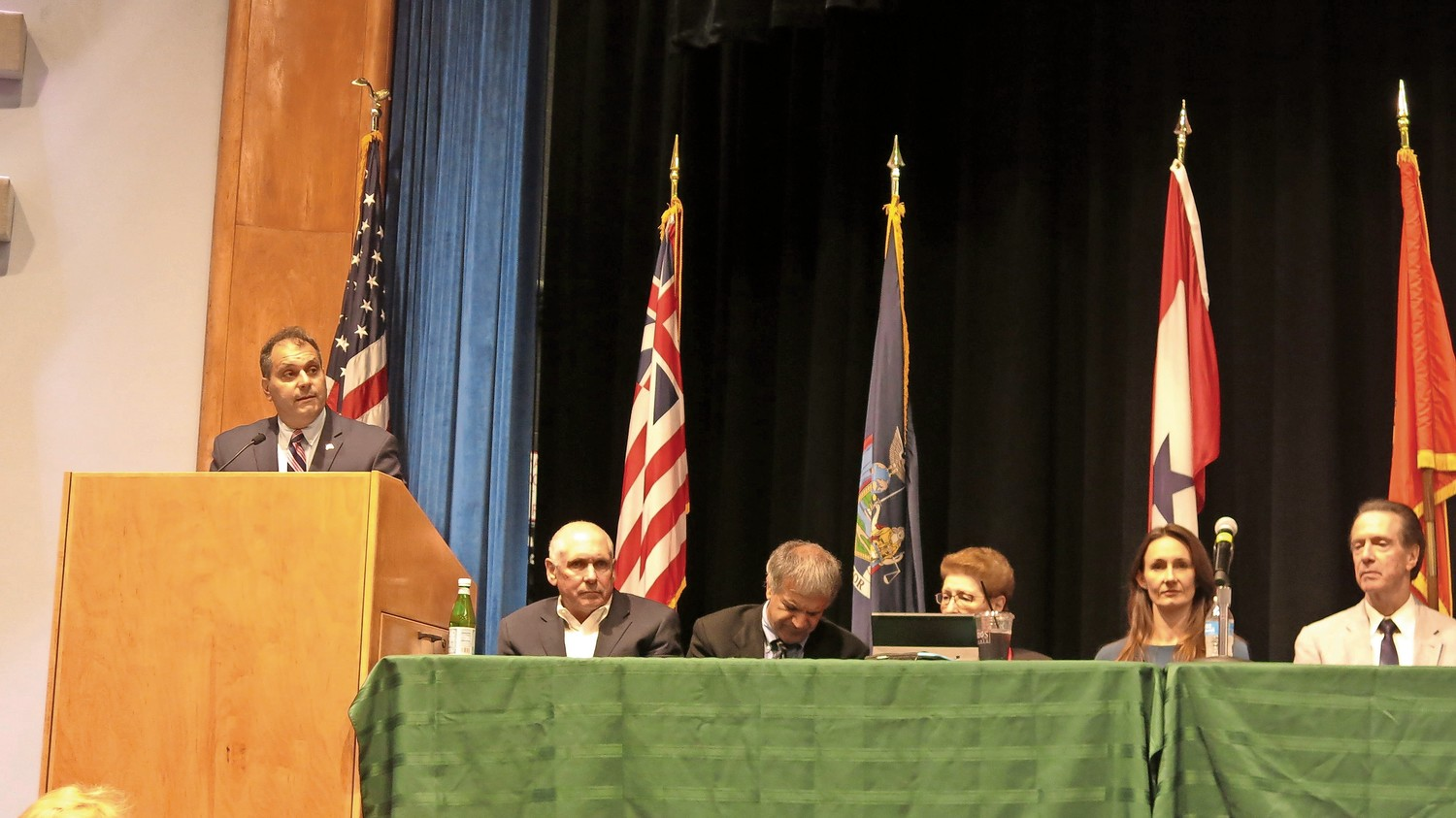 Oyster Bay Town Supervisor Joseph Saladino, far left, with members from the Village of Bayville Anti-Tunnel Committee — from left, John Taylor, Joe Russo, Rena Bologna, Jen Jones and George Jehn — at a meeting at Jericho High School on Monday, where they discussed Gov. Andrew Cuomo's tunnel.