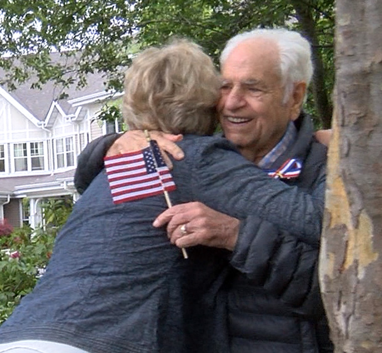 Malverne Mayor Patti Ann McDonald greeted Wagner with a hug at this year's Memorial Day parade.