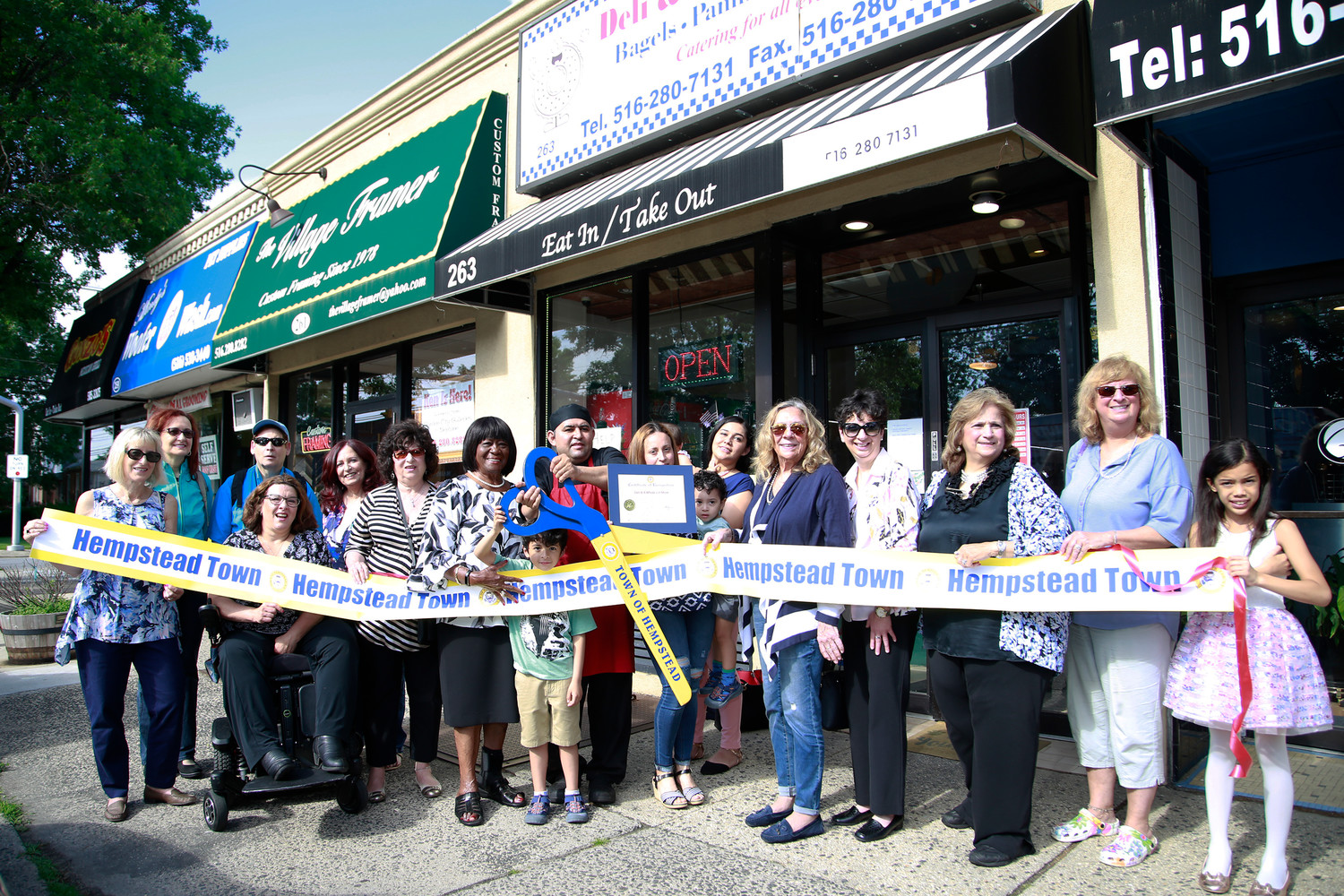 Members of the Long Island Breakfast Club, along with local elected leaders, gathered for a ribbon-cutting ceremony on June 2.