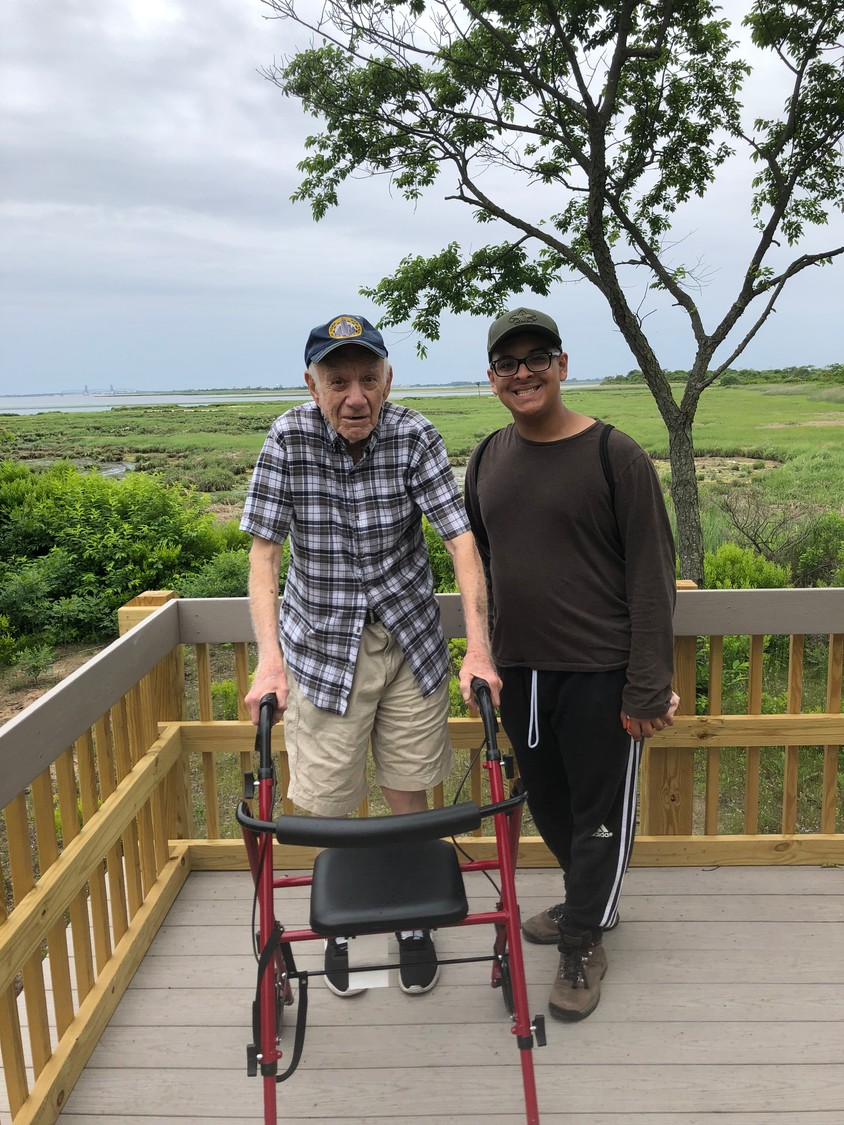 Mario Cernigliaro thanked Dylan Roca for repairing the walkway at the Jamaica Bay Wildlife Center.