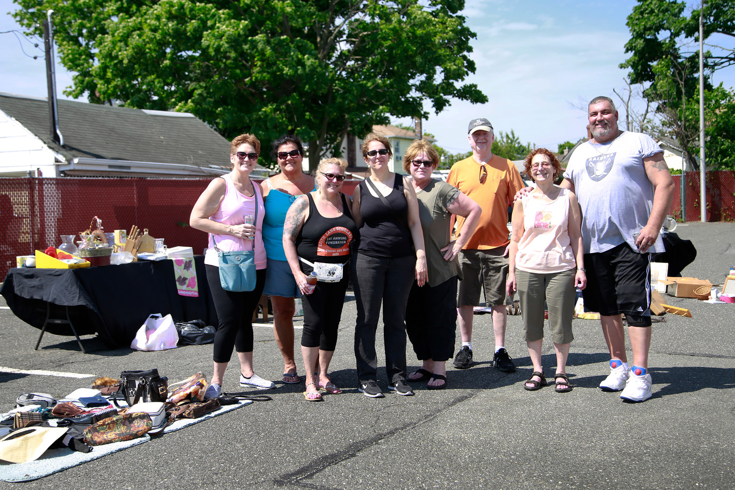 Stacy Lane-Navarra, third from left, organized the second annual fundraiser to benefit a scholarship in memory of her late brother, Keith Lane. Above, Lane-Navarra with Angie Seaman, far left, Maryann Briones, Laura Freedman, Trish Appello, Rick Newel, Leslie Newel and Pete Navarra.