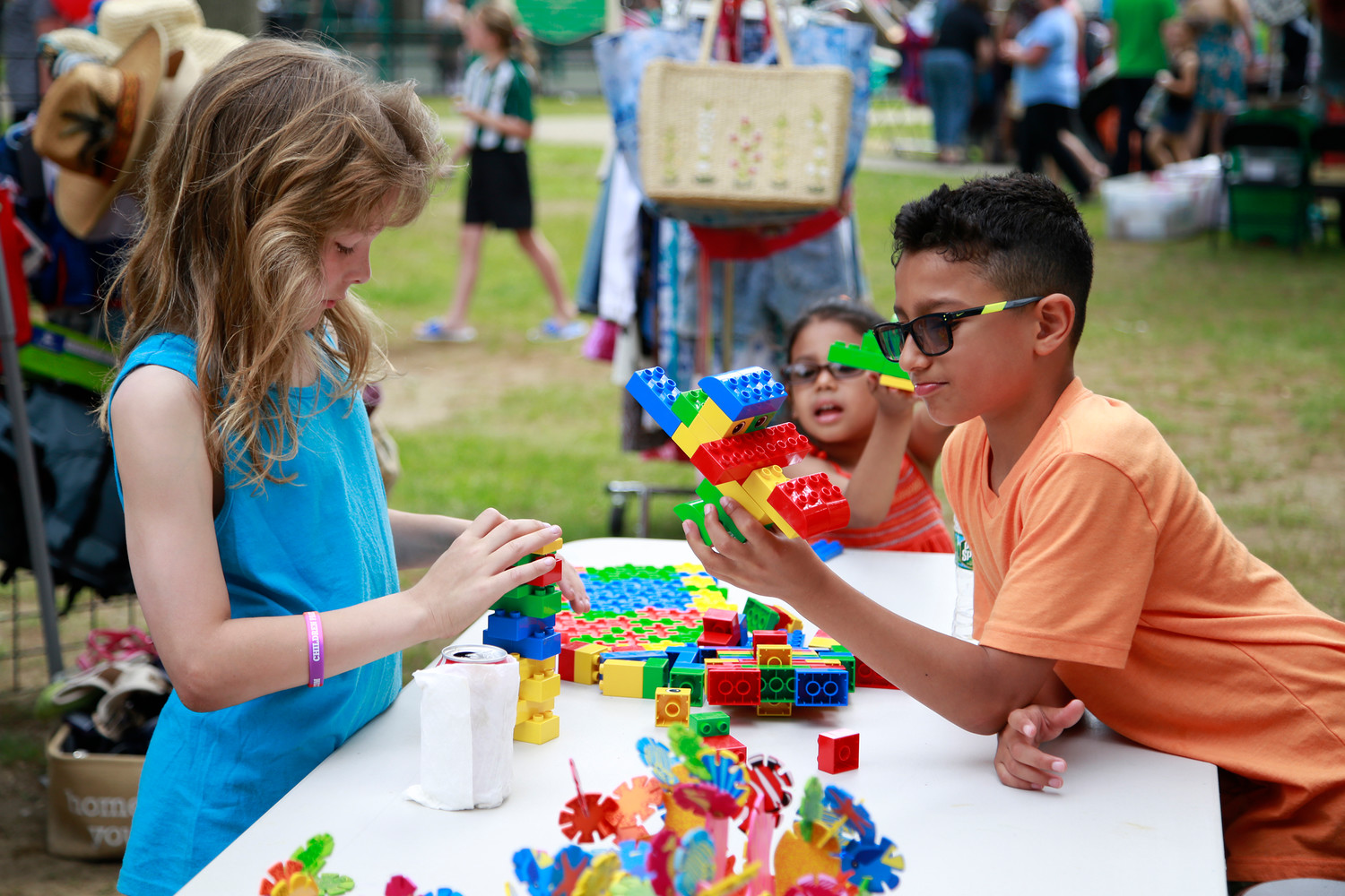 Thomas Schilling, right, Aden Alvarez and Maya Alvarez played with Legos at Memorial Park.