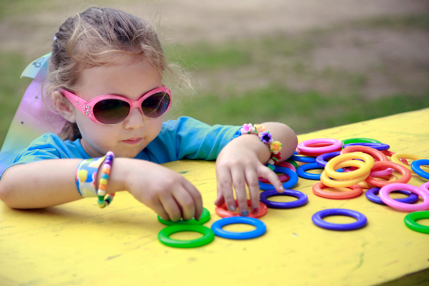 Payton Conklin, 6, helped her mother organize the rings for the ring toss game at the 49th annual Huckleberry Frolic last weekend.