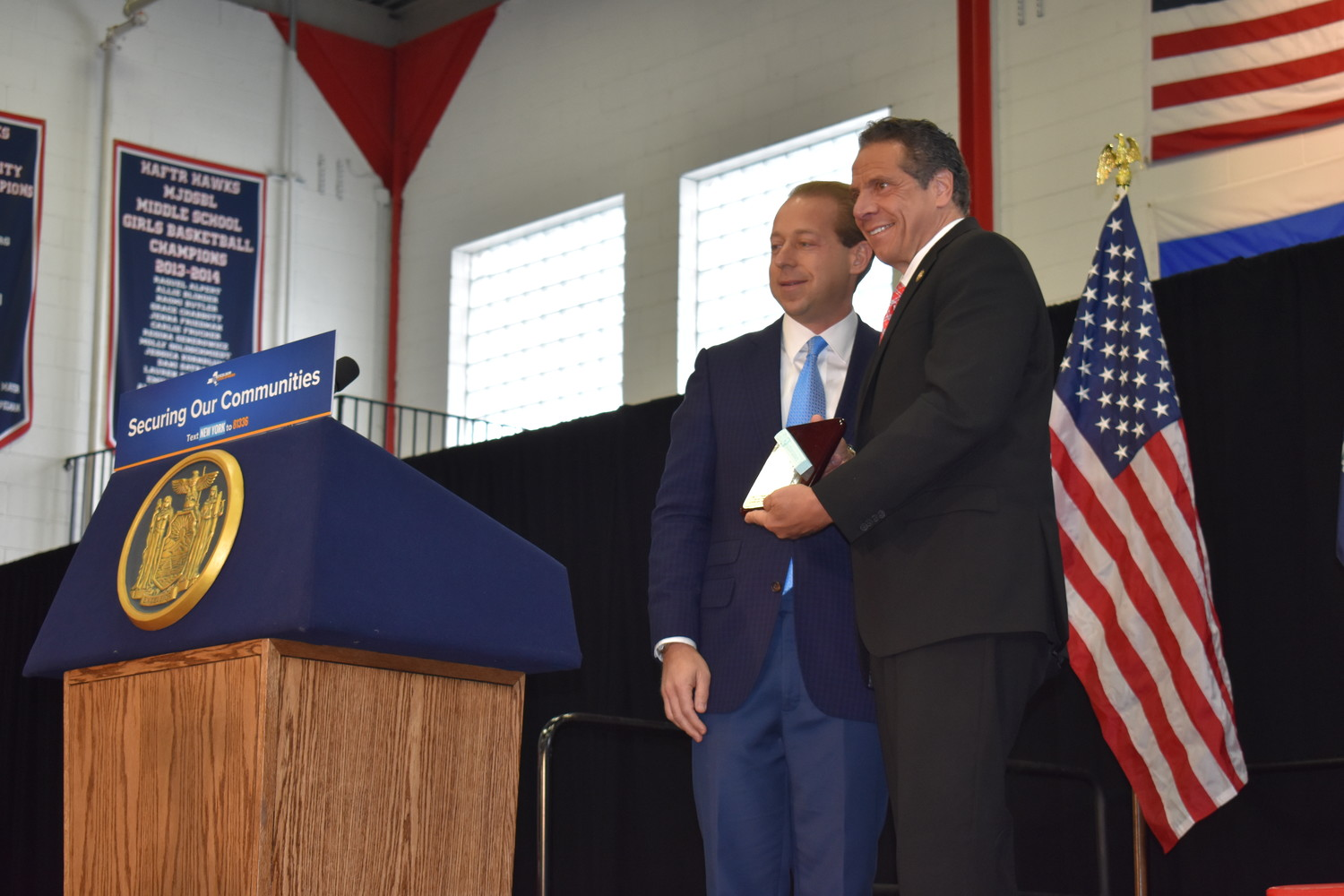 HAFTR's Vice President of Political Affairs, Cal Nathan, presented Gov. Andrew Cuomo with a mezuzah, a verse from the Torah in a decorative container, that students made using a 3D printer in the school's STEM lab.