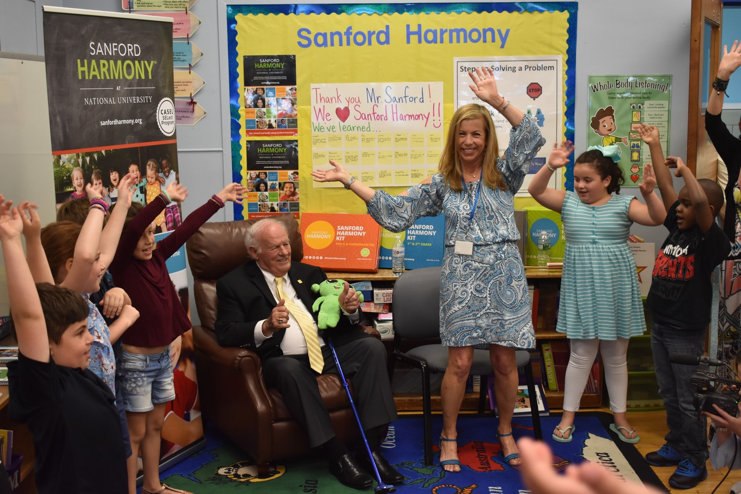 Meryl Goodman danced with her second-grade students at William S. Covert Elementary School on June 6. The lesson was part of Sanford Harmony, a social and emotional learning program inspired by billionaire philanthropist Thomas Denny Sanford, who watched.
