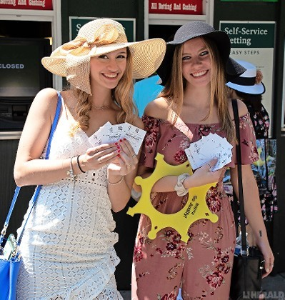 Tara Mandel, left, and Michelle Gregorovic of Farmingdale made their share of wagers on Belmont Stakes Day.