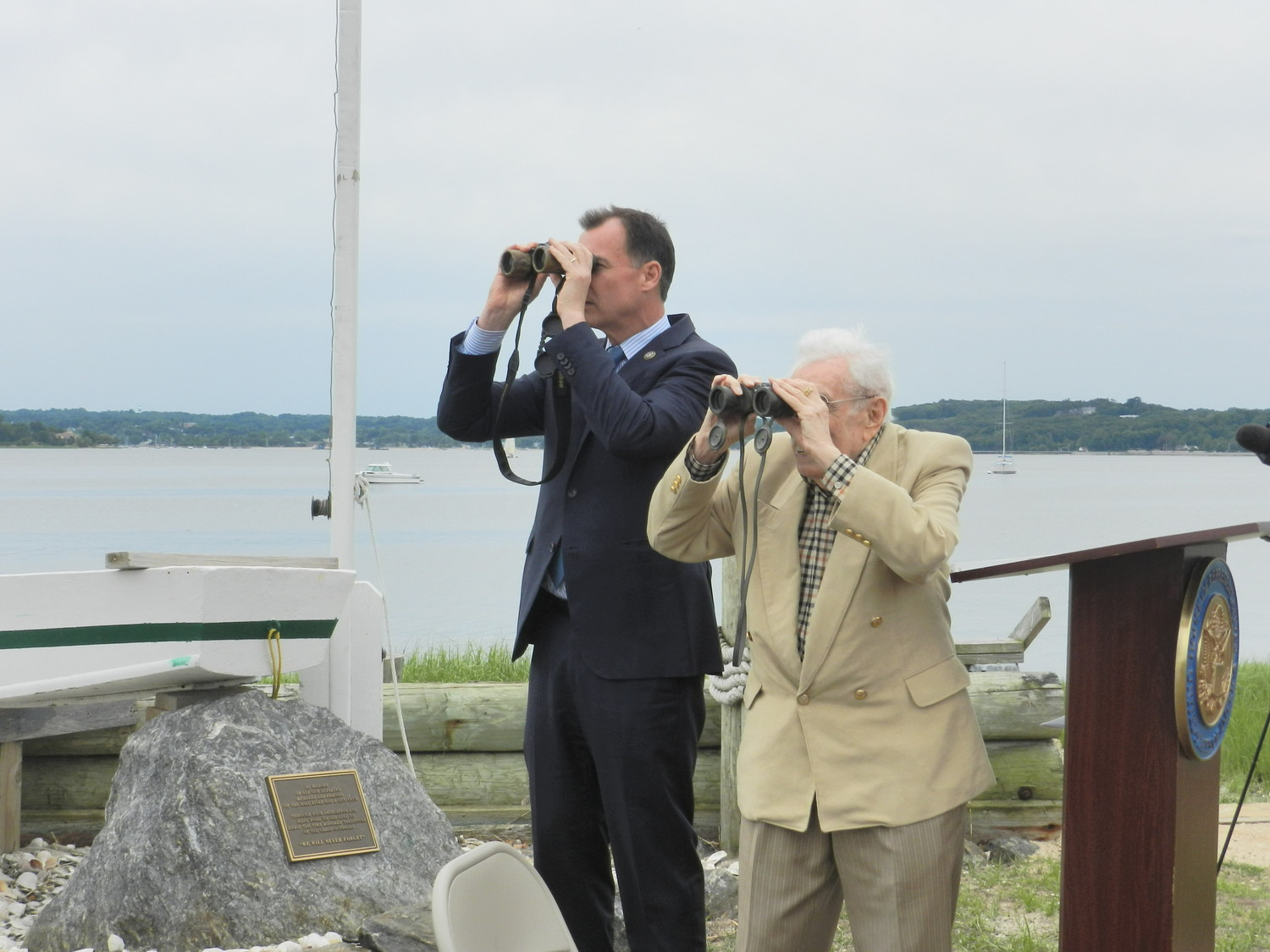 With the help of binoculars, Suozzi and Wolff kept their eyes peeled for the ospreys.