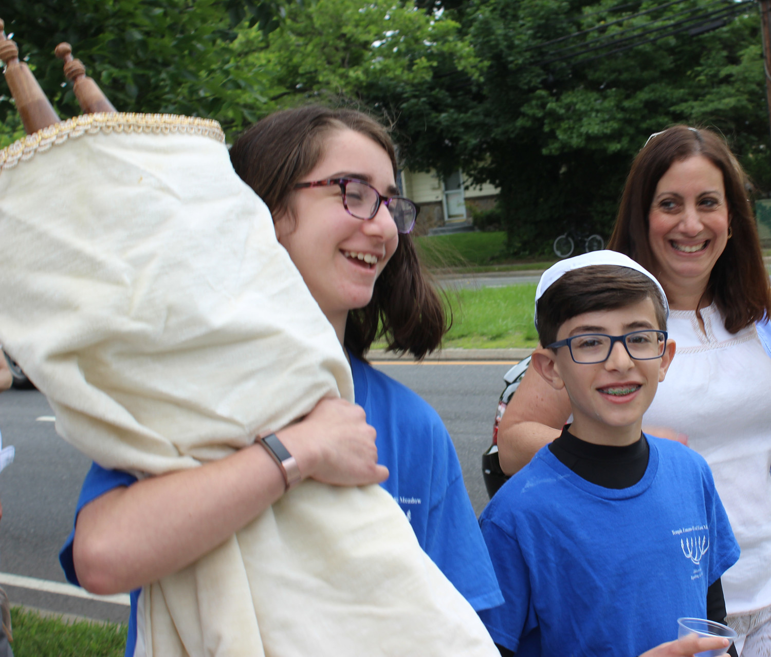 Addison Baroukh, 12, left, had the last bat mitzvah at Temple Emanu-El, reaching the age at which she could carry the torah. Her brother Judah, 11, will celebrate his bar mitzvah at Temple B'nai Torah.