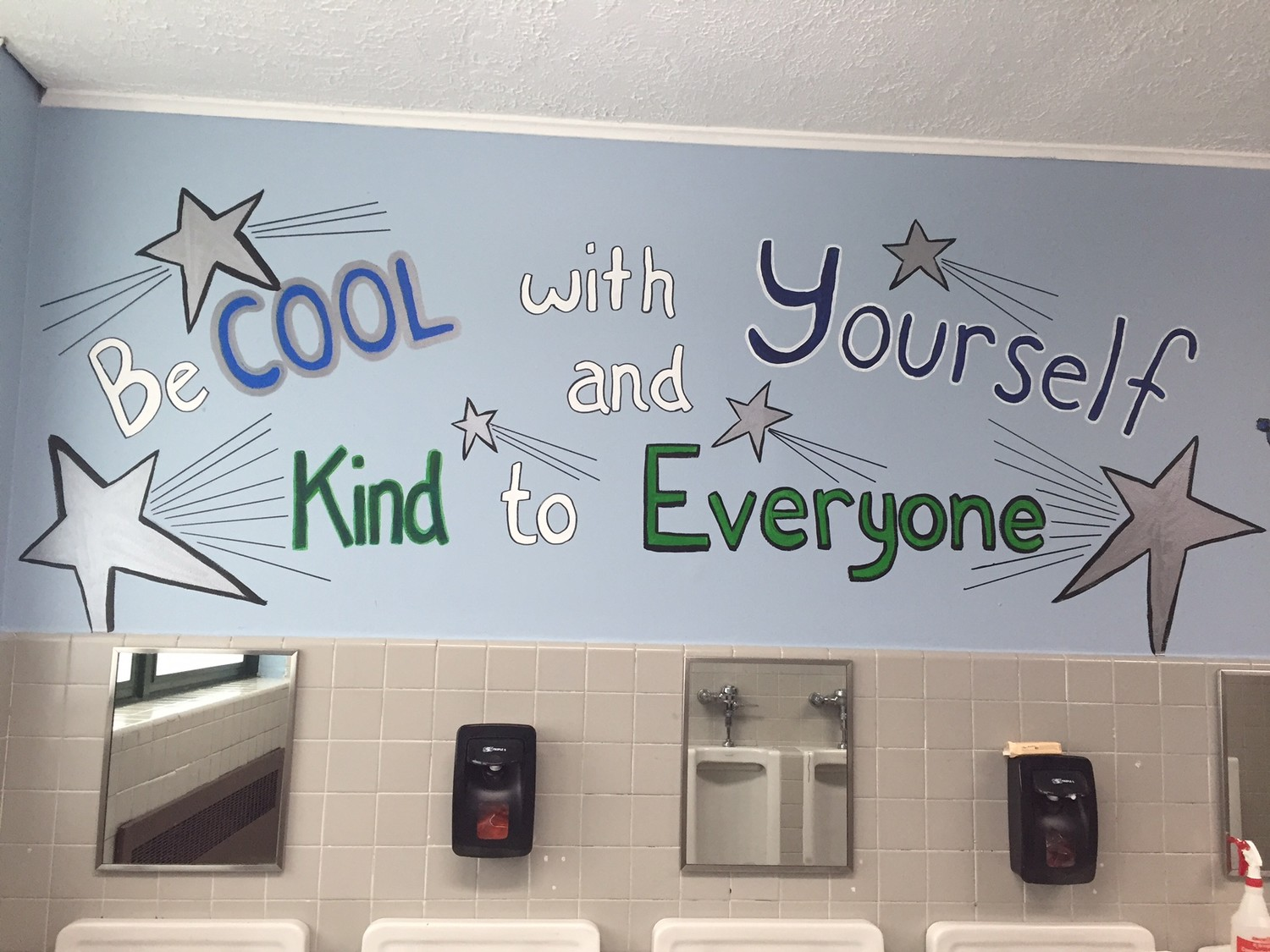 An inspirational message painted on the boy's bathroom wall at Manor School as part of the Choose Kind initiative.
