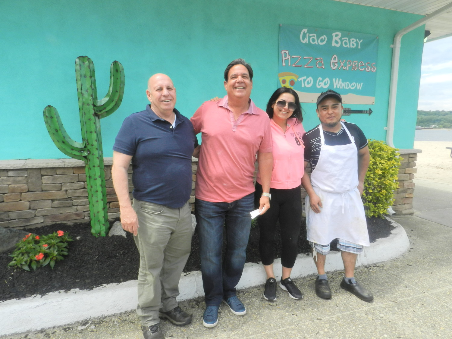 Roy Monaco, the owner, far left, Joe DiGirolomo, the general manager; Danielle DiGirolomo, the manager; and Ricardo Ramirez the head chef, make up Blu Iguana's staff.