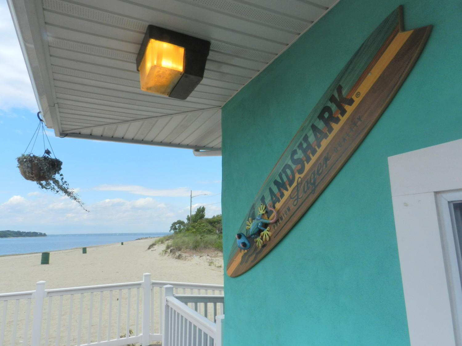 The restaurant's bright blue exterior makes it a standout spot at Tappen Beach.