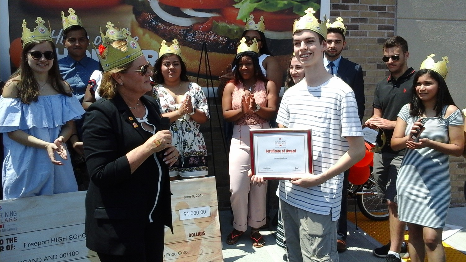 reeport High School Senior, James Hastings, right was presented with a certificate of recognition and a $1000 college scholarship by Debbie Sena, owner of the new Burger King