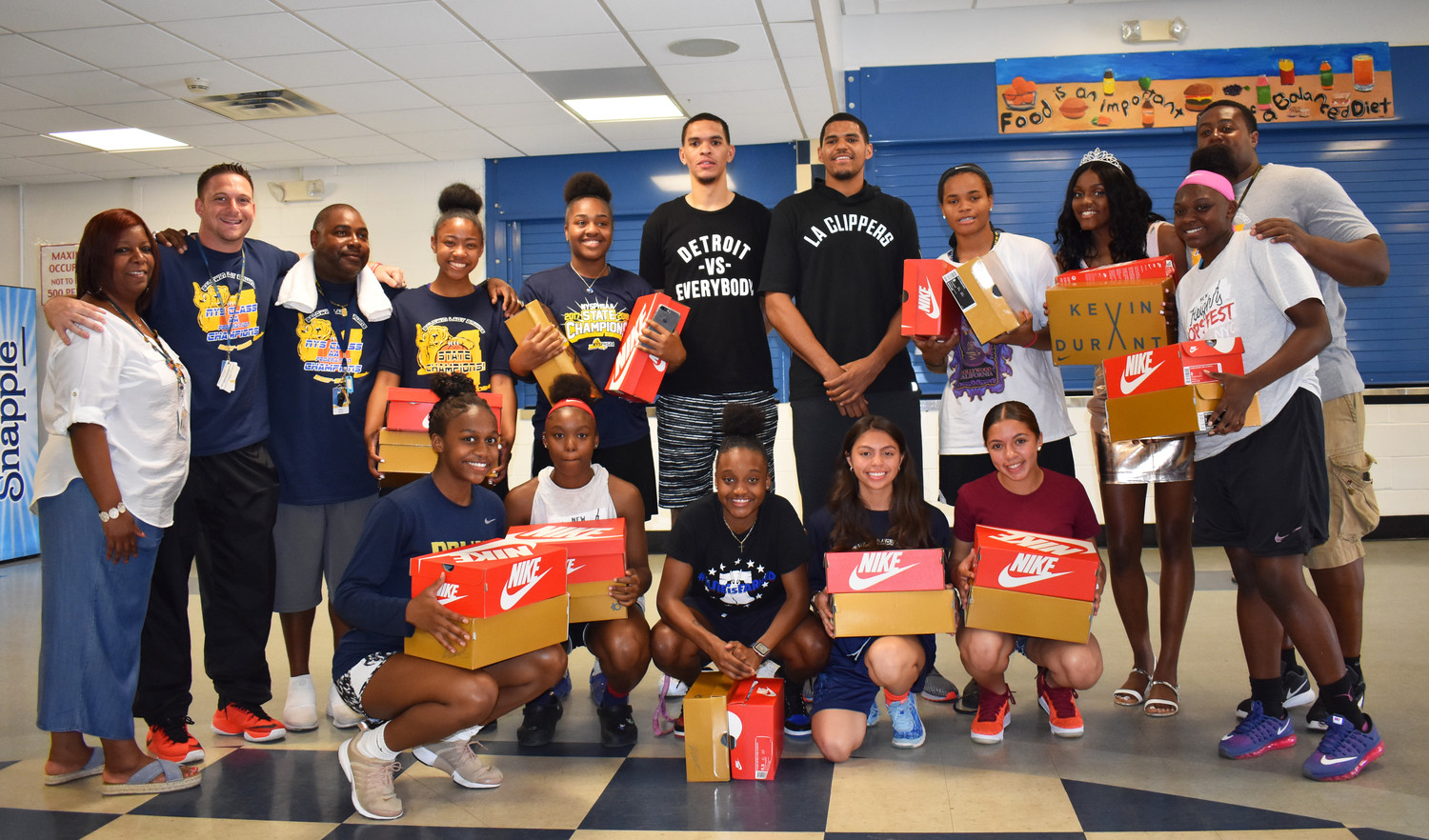 Los Angeles Clippers forward Tobias Harris, back row, fourth from right, honored Baldwin's state champion girls' basketball team on May 24 and with some Nike gear.