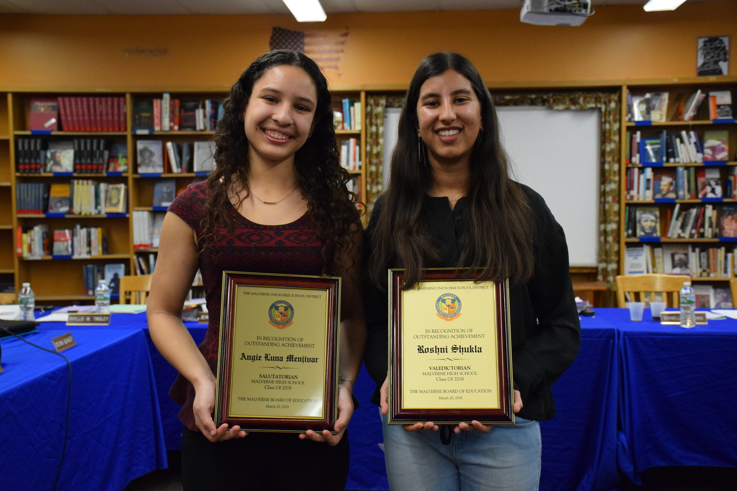 Angie Luna Menjivar, left, and Roshni Shukla received plaques from the Malverne School District's Board of Education recognizing their academic success.