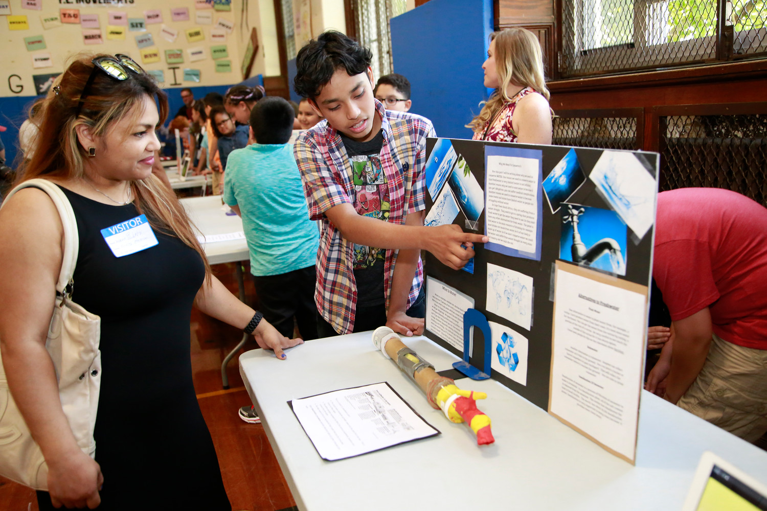 Jasper Lopez, above right, explained his project on water to his mother, Maria.