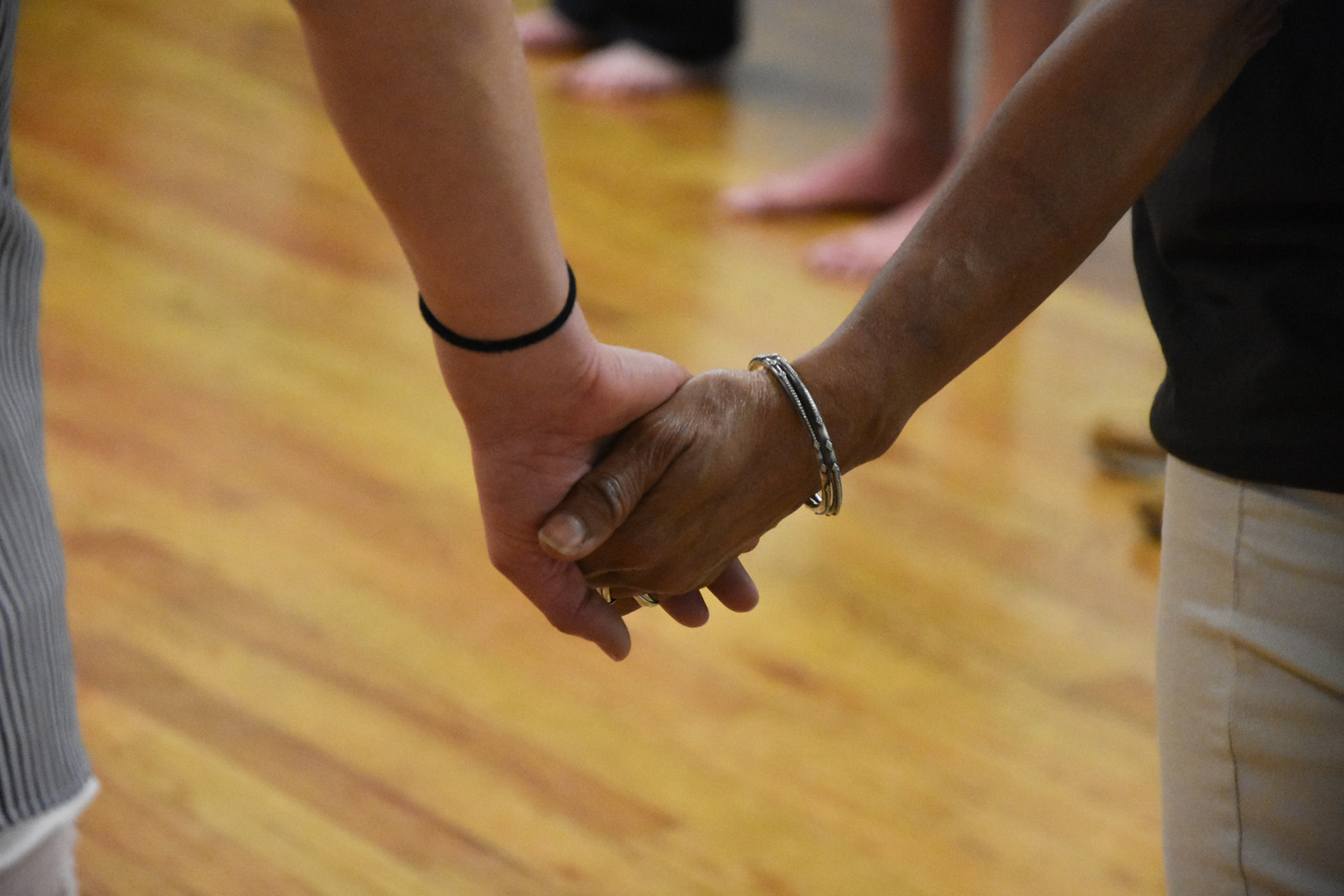 The dancers held hands with friends and strangers.