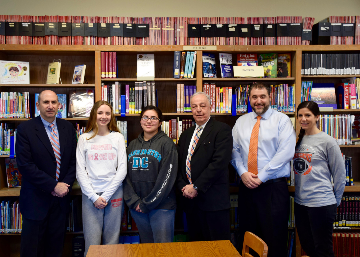 Marissela Gomez, third from left, will represent East Rockaway Junior-Senior High School's class of 2018 as valedictorian, and Gabby Walsh, second from left, will be salutatorian. Above, the students with Assistant Principal James DeTommaso, left, Interim Principal Neil Lederer, Director of Guidance Andrew Rosenberg and guidance counselor Jennifer Melecio.