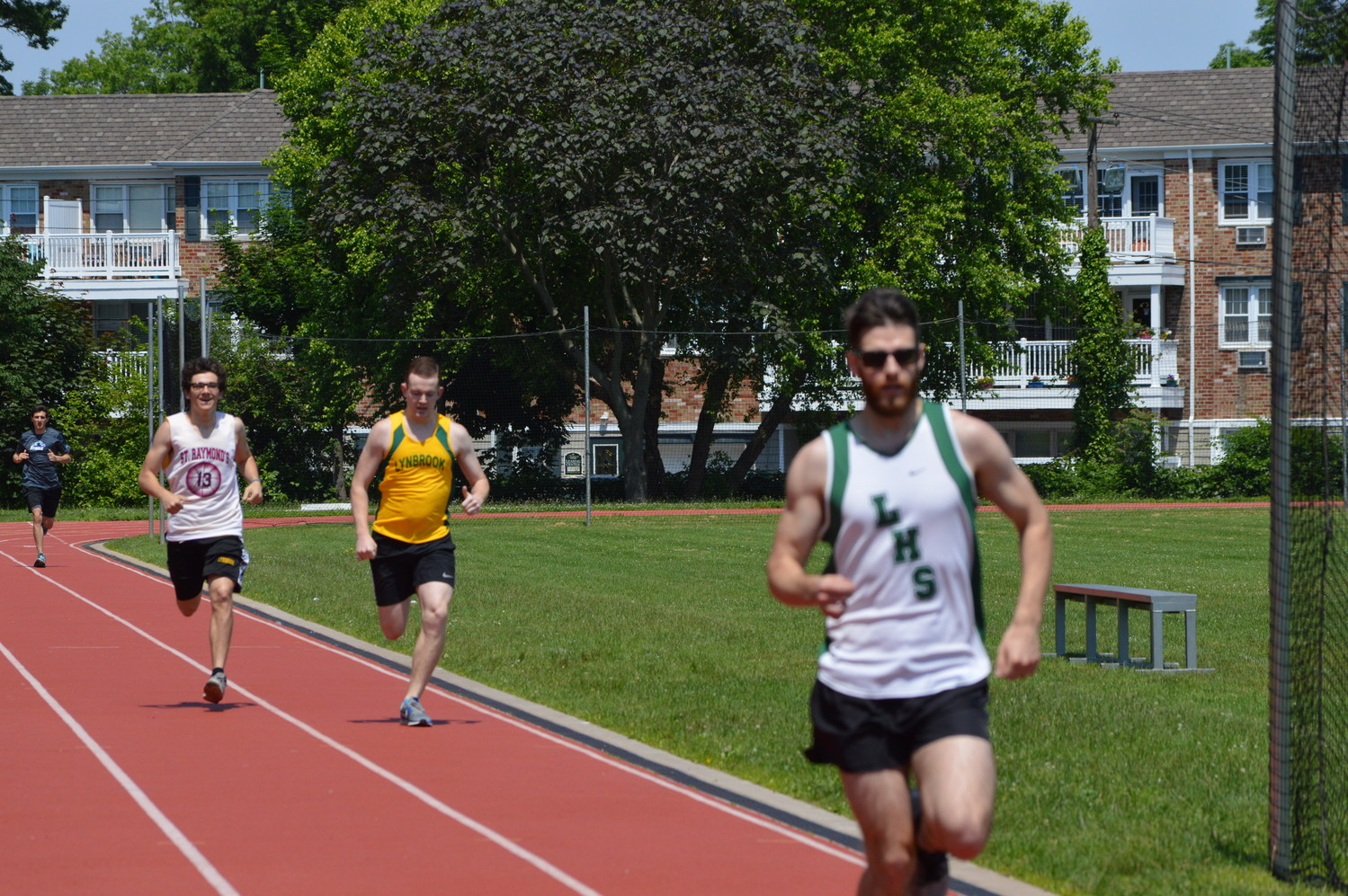Russell Darren (All-County 2008), front right, won the 800-meter race with Brendan Kelly (All-County 2016), left, and Walter Paskoff (All-County 2018) closely behind him.