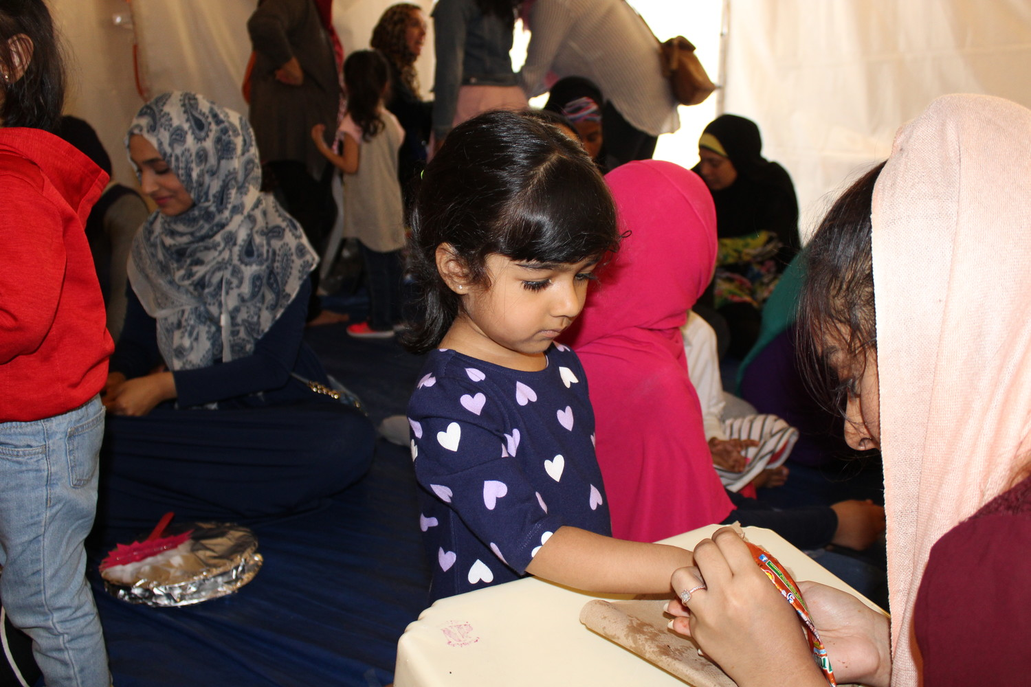 Aisha Zubair, age 3½, got a henna tattoo at Masjid Hamza in Valley Stream as part of the mosque's weeklong Eid ul-Fitr celebrations.