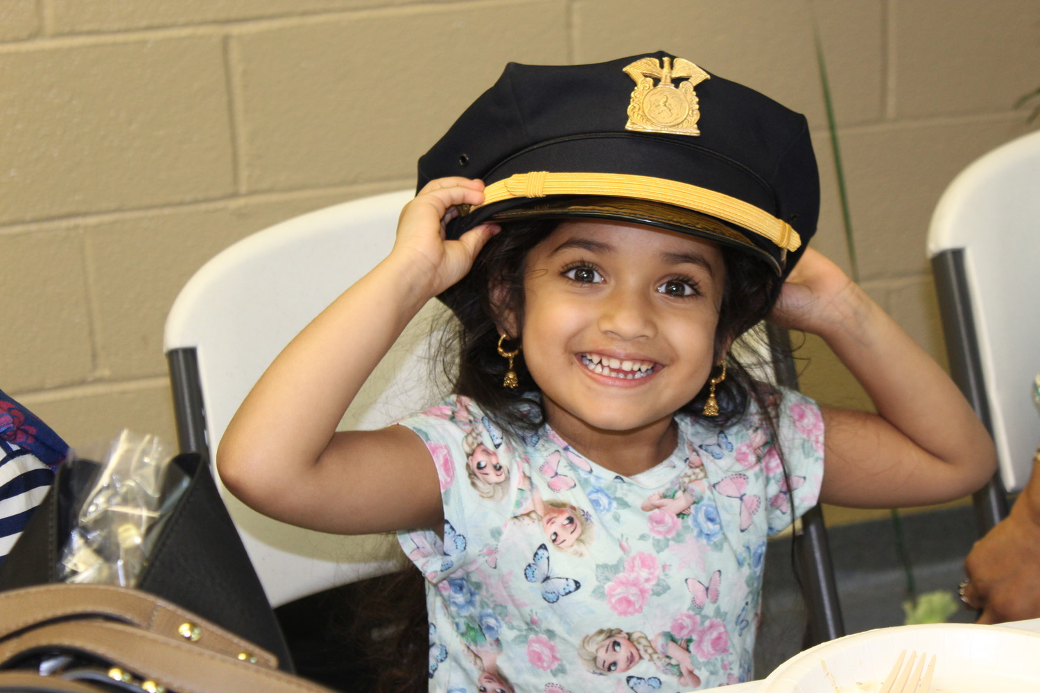 Layla Khan, 4, at left, donned her grandfather's auxiliary police hat.