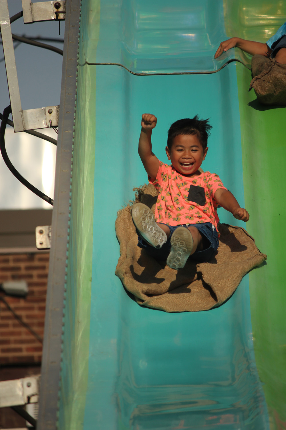 Five-year-old Nikolas Dagan had a blast on the slide.