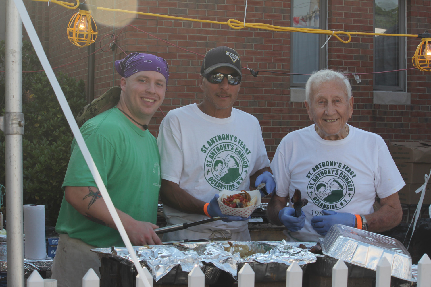 Volunteer Tony Ditizio, far right, started it all 49 years ago when St. Anthony's Church held its first feast. He was joined by his godson, Dominic Albanese and Rich Giambrone.