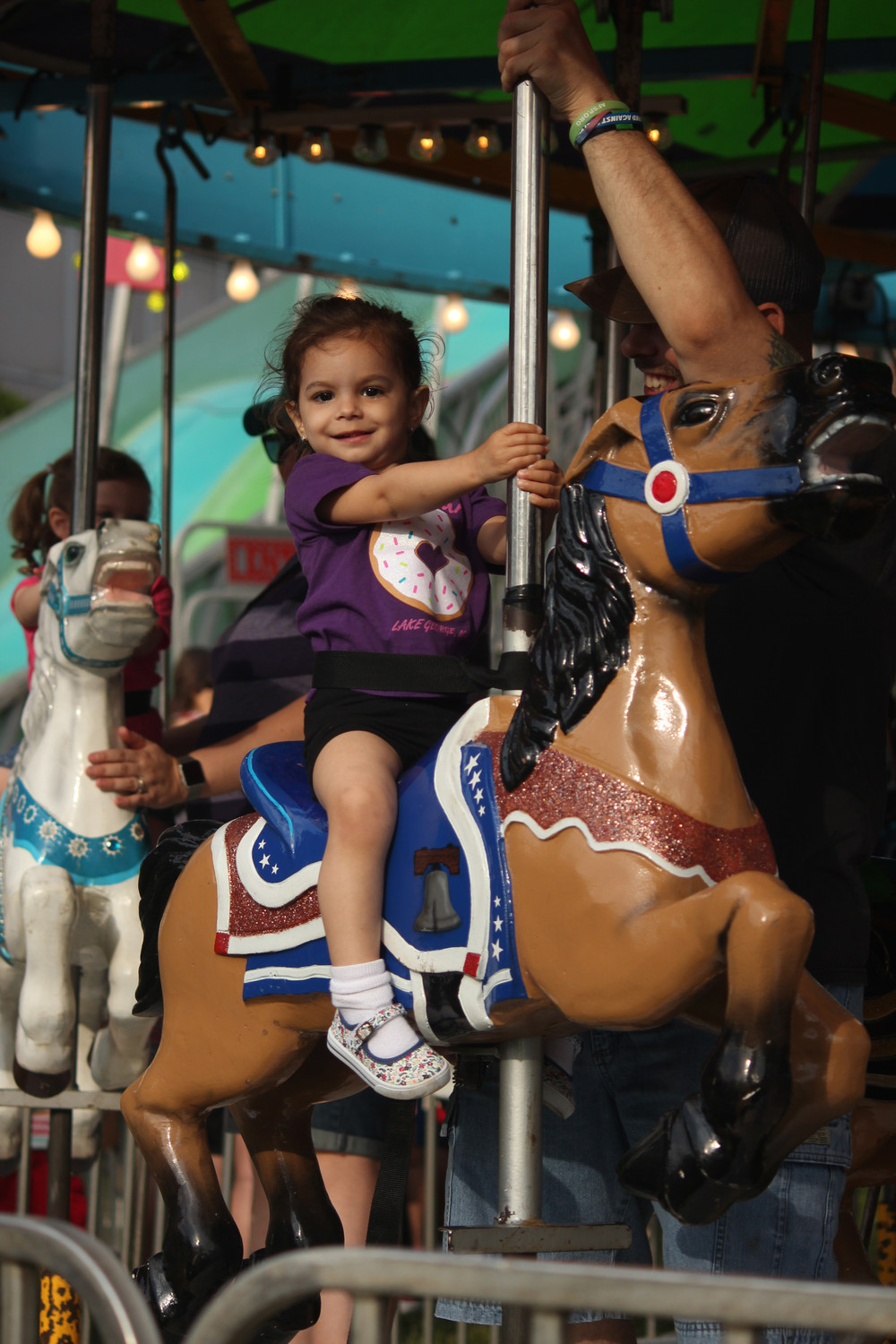 Hannah Demetriou, 2, took a regal spin on the carousel.
