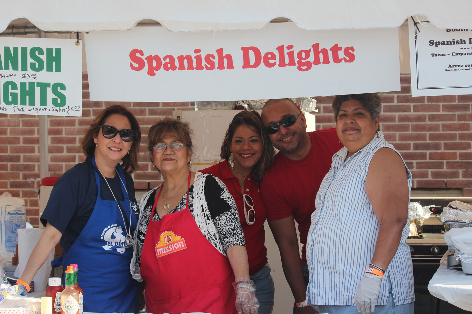 Volunteers Rosmery Madera, left, Maria Dodge, Yudalis Jimenez and Lidia Hernandez served up Spanish delights.