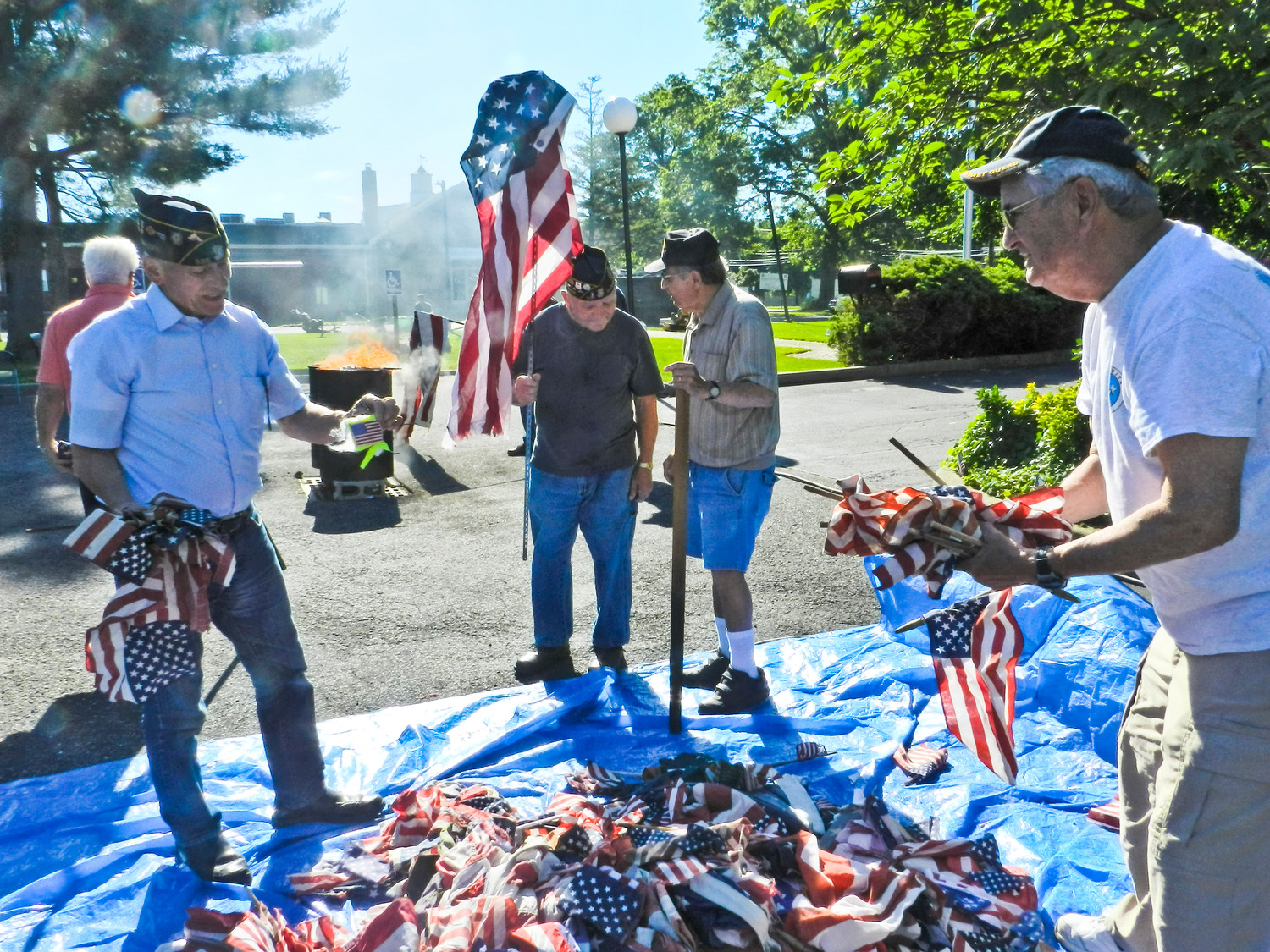 William Laderer, left, Rocco Douso, Carter Haff and Lou Guadagni sifted through the pile of donated flags.