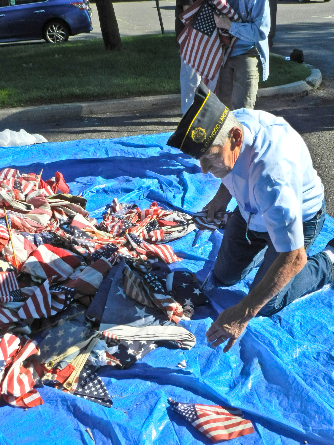 Commander William Laderer rummaged through the pile of flags.