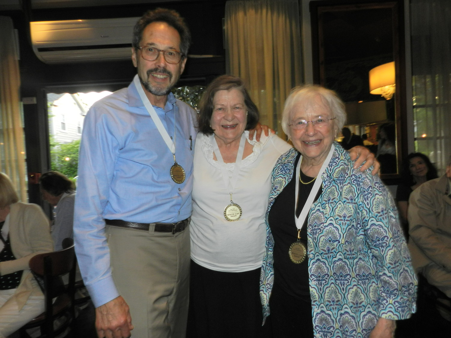 The 2018 White Caps recipients: Charlie Weinstein, Estelle Moore and Mimi Leipzig.