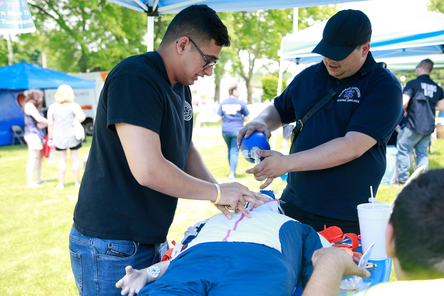 Mahdi Remtulla and Lt. Frank Iadevia work on a simulated patient.