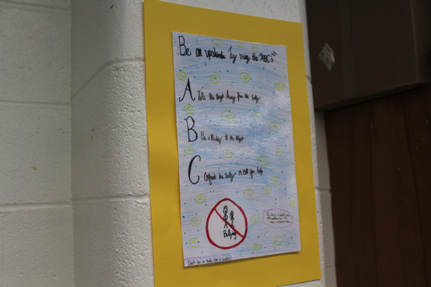 Fifth-grader Meghan Kalman's poster about bully drills was hung inside Kerry Hansen's classroom. Similar posters also appear throughout the building.