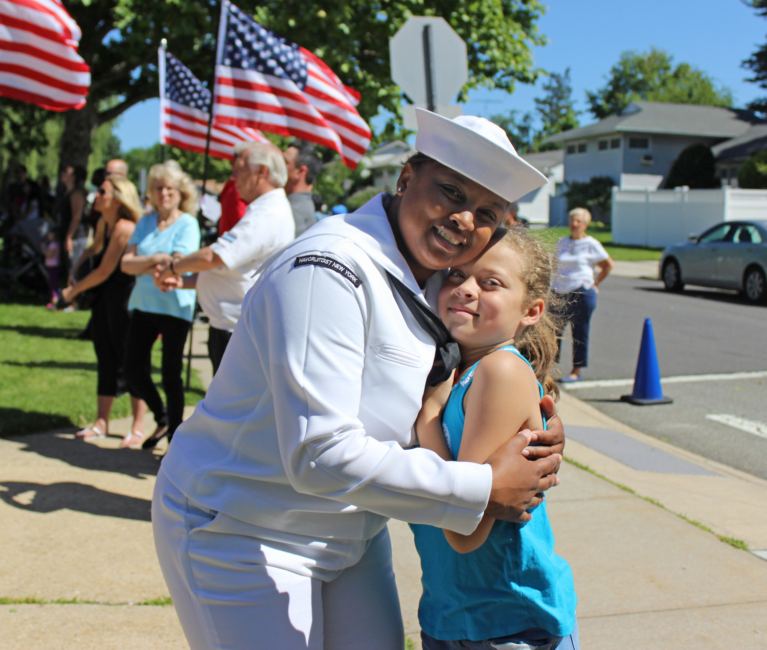 Officer Tara S. Virgin represented the U.S. Navy at the Flag Day ceremony at Barnum Woods, where her daughter Oriana, 9, is a student.