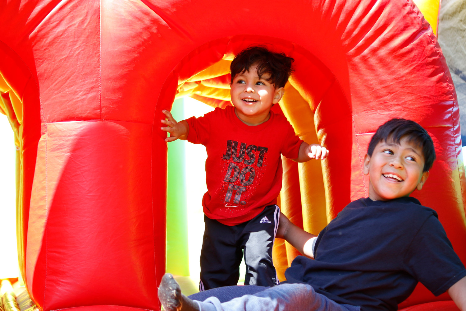 Carlos Mendoza had a lot of fun inside the bouncy obstacle course at East Meadow's 27th annual Pride Day.