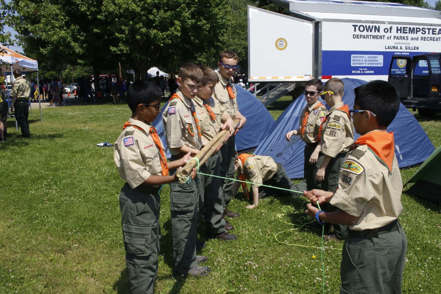 Boy Scout Troop 362 practiced tying knots, lashing, making tripods and creating a 12 foot flagpole out of bamboo. They also demonstrated the knot tying to curious guests.