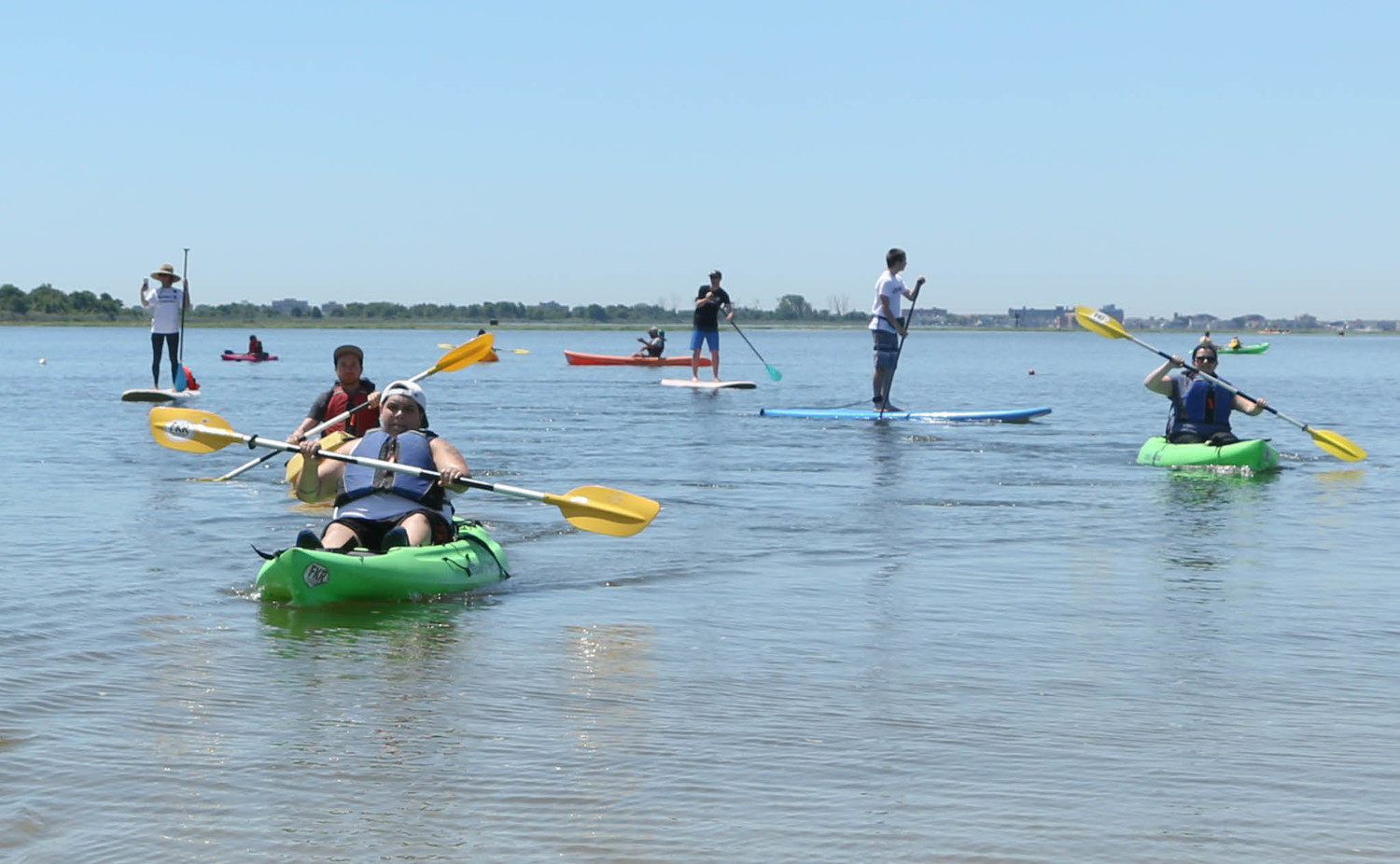 Glen Cove native, Jackie Comitino, left corner,  paddled on Hewlett Point Park,East Rockaway.