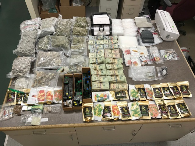 "As part of a search of a suspected drug den, police recovered over four pounds of marijuana, a large quantity of hallucinogenic psilocybin mushrooms, MDMA — a club drug also known as ""molly"" — LSD, Xanax, over 75 vaping cartridges containing THC — the psychoactive chemical in marijuana — THC wax and THC candy edibles."