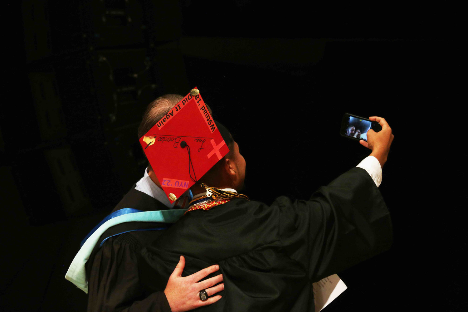 Students also took selfies at the graduation ceremony.