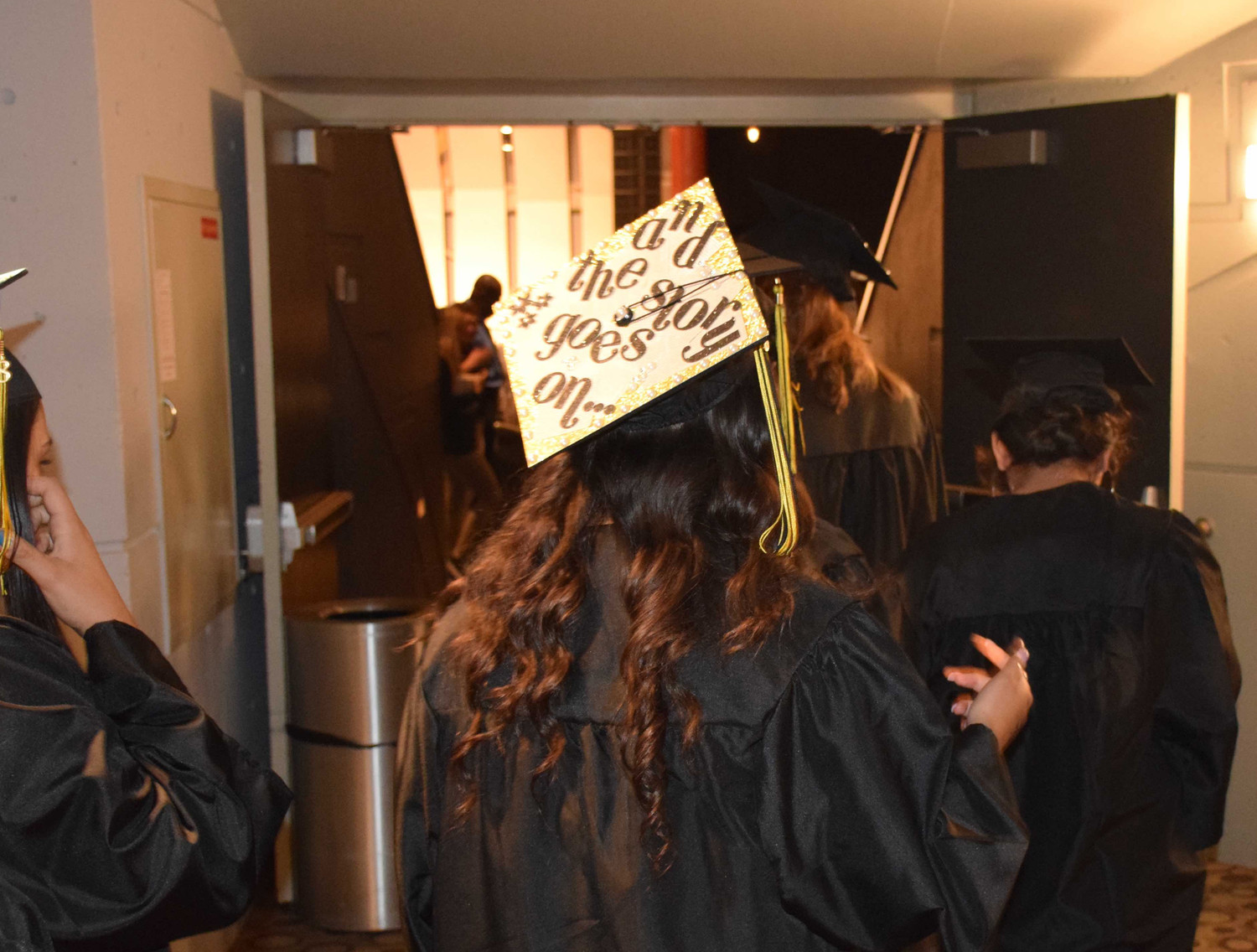 Many of the graduates wore decorated mortarboards.